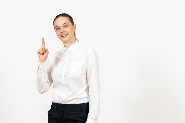 Front view young woman in white blouse raising her finger on white background job office female feeling model emotion