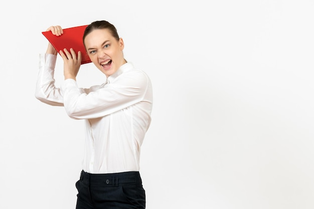 Front view young woman in white blouse with red file preparing to hit with it on white background office female emotion feeling model job