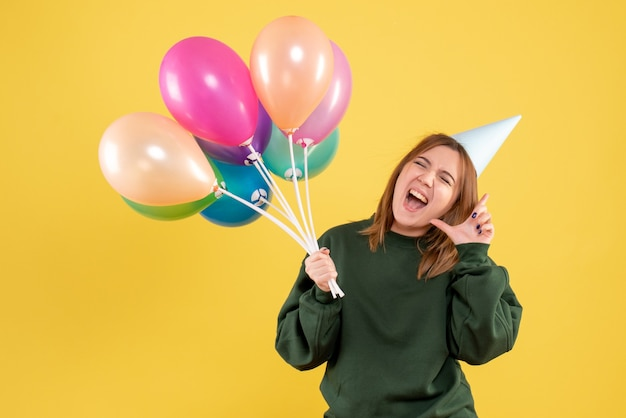 Front view young woman with colorful balloons