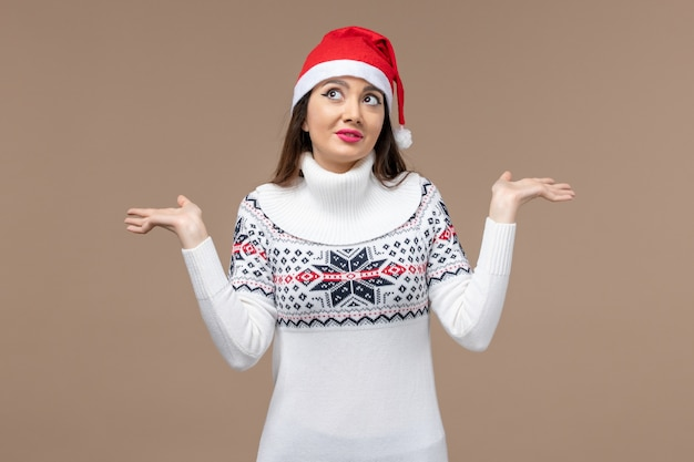 Front view young woman with dreaming expression on brown background emotion christmas new year Free Photo