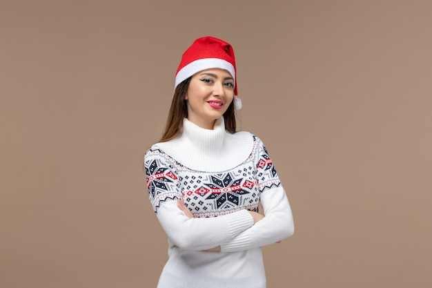 Front view young woman with smiling expression on brown background new year emotion christmas
