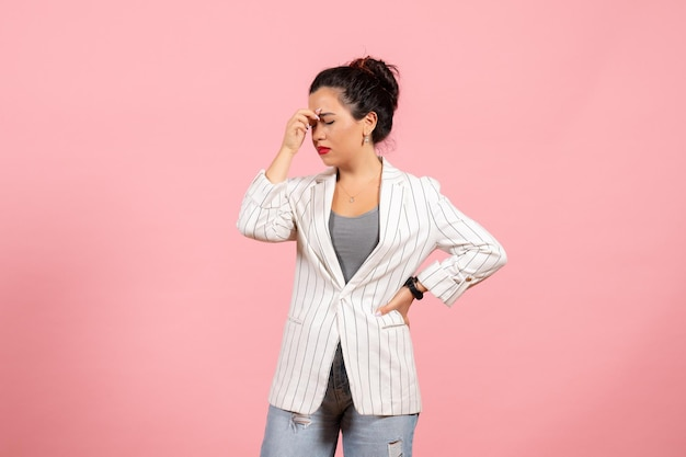 Front view young woman with white jacket having headache on pink background lady fashion woman emotions color