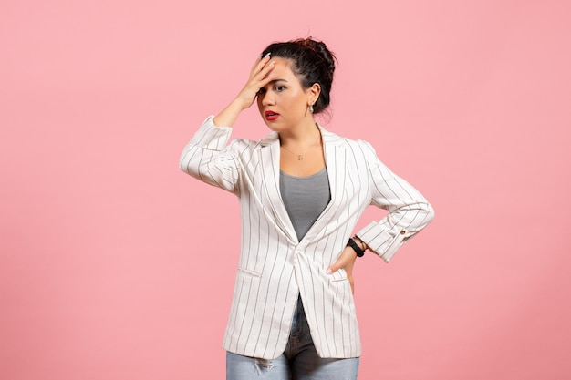 Front view young woman with white jacket on pink background lady emotions fashion woman color feelings