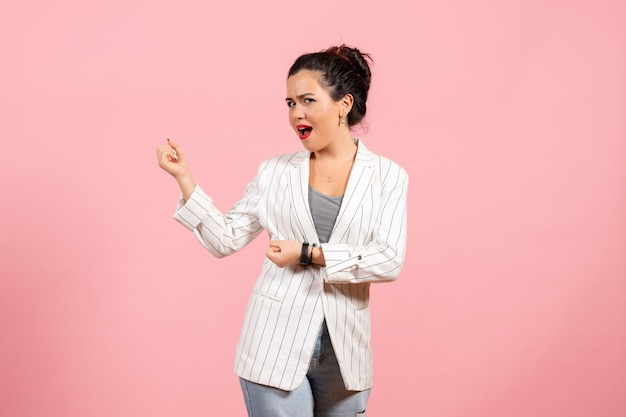 Front view young woman with white jacket posing on pink background lady fashion woman emotions color