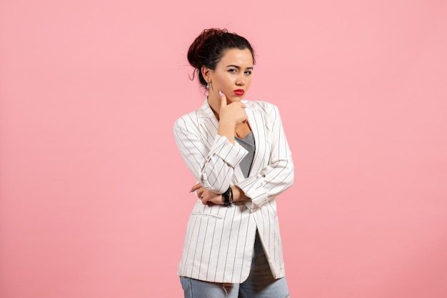 Front view young woman with white jacket thinking on pink background lady emotions fashion woman color feeling