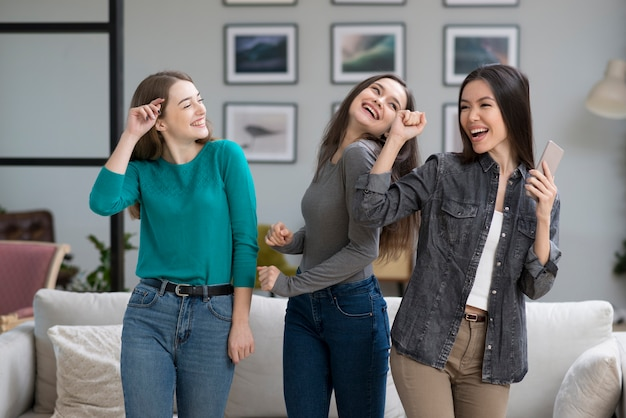 Front view young women happy together at home