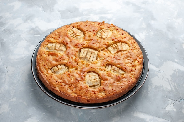 Front view yummy apple pie sweet baked inside pan on white desk pie cake biscuit sweet sugar bake