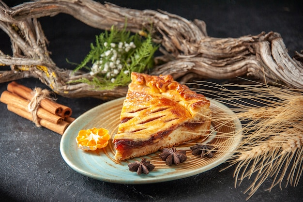 Front view yummy jelly pie slice of it on dark background biscuit pie oven bake sweet dough sugar cake dessert