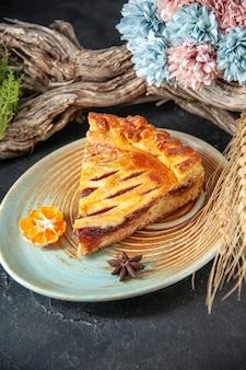 Front view yummy jelly pie slice of it on dark background biscuit pie oven dessert bake sweet dough sugar cake