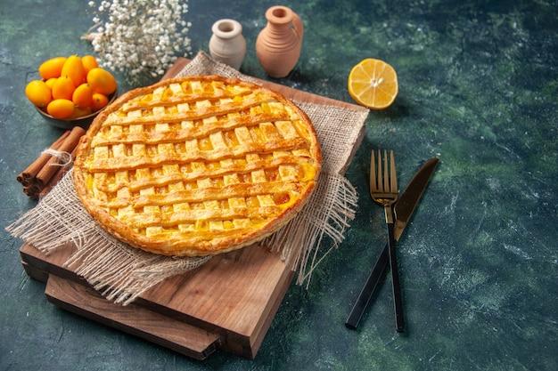 Front view yummy kumquat pie on dark blue background
