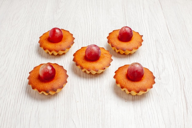 Front view yummy little cakes for tea on white background dessert biscuit tea cake pie cookie