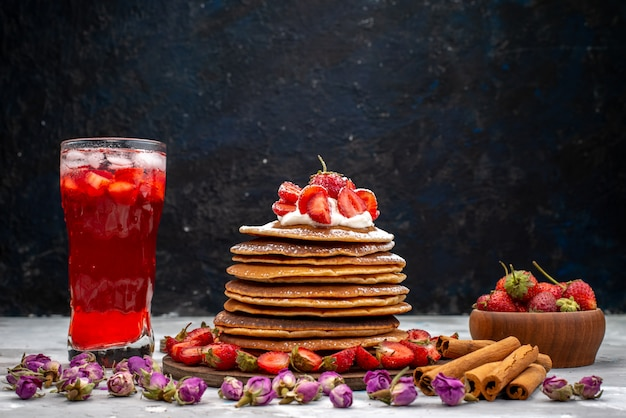A front view yummy round pancakes with fresh red strawberries cinnamon and strawberry cocktail cake
