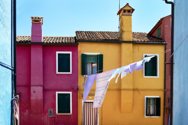Front of the yellow  and red houses on the island of burano.
