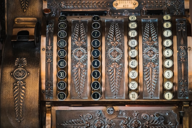 Frontal close-up of an antique cash register