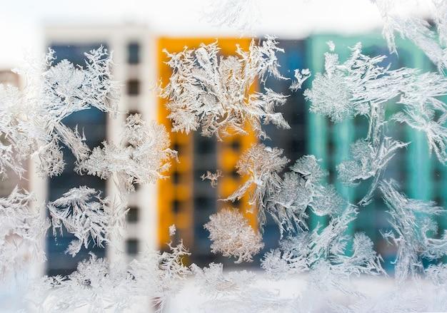 Frost patterns on a frozen window in winter