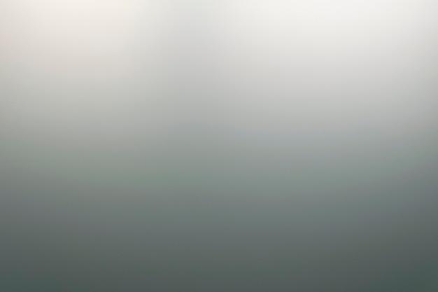 가벼운 오버헤드 조명이 있는 젖빛 유리 질감
