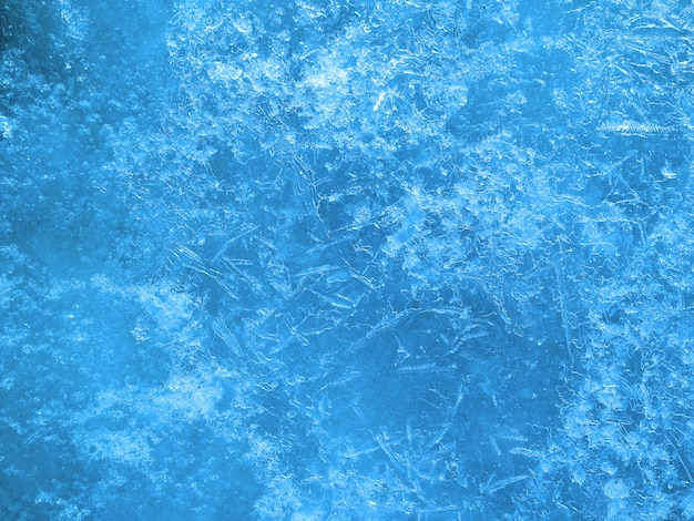 冷ややかな質感。ひびの入った美しい氷。氷の表面。高品質の写真