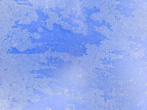 Морозная текстура. красивый лед с трещинами. ледяная поверхность. фото высокого качества