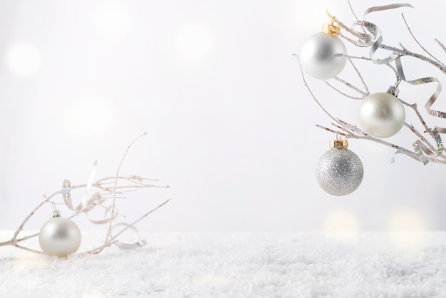 Frosty tree branch with snow and christmas decoration i on white . attach your product