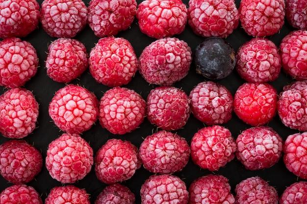 Frozen berries on dark background.