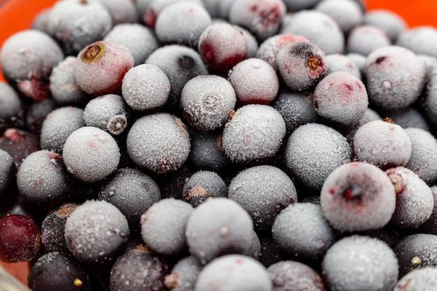 Frozen black currant berries close up