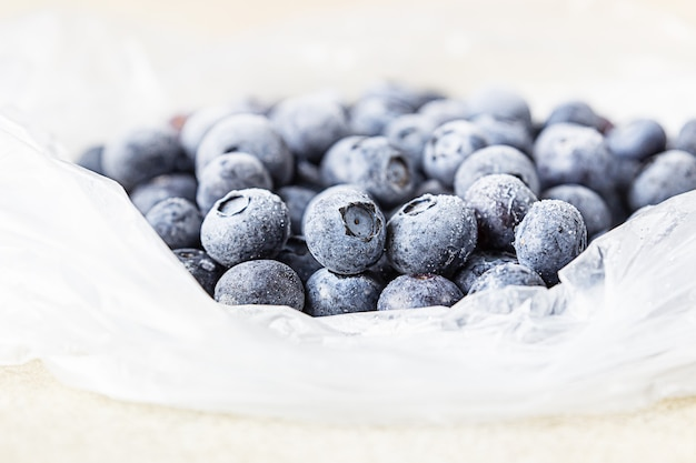 Frozen blueberries in transparent plastic bag. close up. concept of healthy eating.