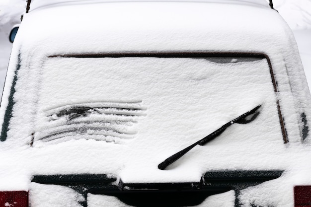 Frozen car in the snow. view from below. high quality photo