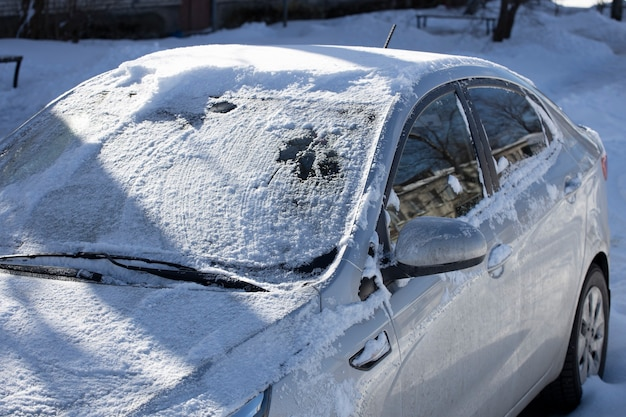 Frozen car on the street of the city in winter. high quality photo
