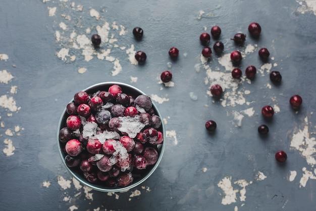 Frozen cherries on light grey background