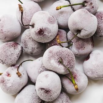 Frozen cherries on white background