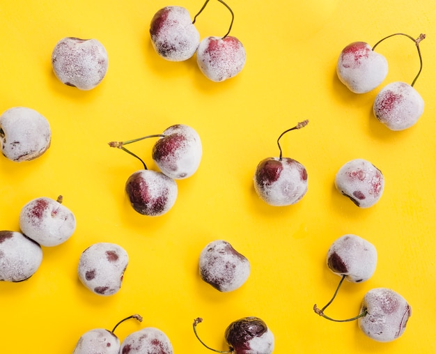 Frozen cherries on yellow background