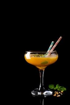 Frozen cocktail smoothie margarita on a black glass background