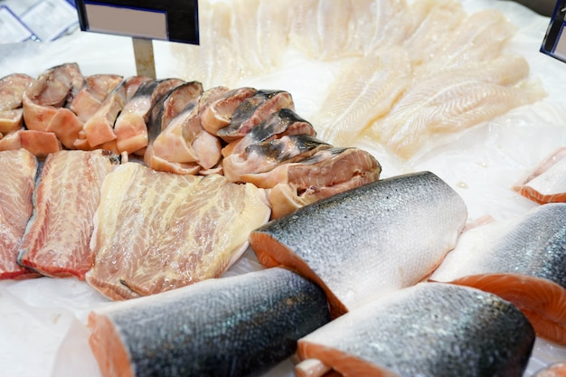 Frozen fish salmon in ice in the supermarket , fresh food