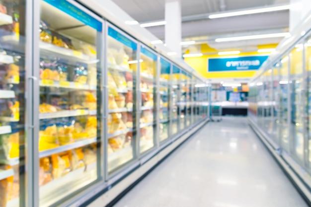 Frozen food freezers in the supermarket. defocused background.