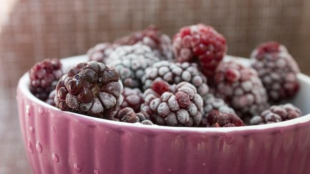 Frozen food, frozen blackberries, frozen berries. frozen blackberry close-up.