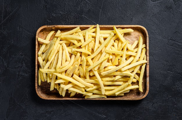 Frozen french fries in a wooden bowl.