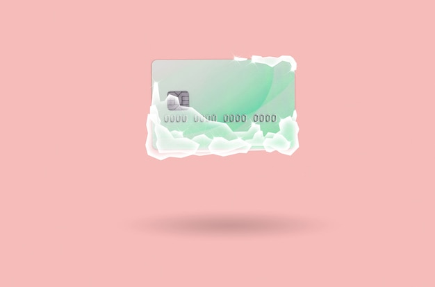 Frozen green credit card in white ice blocks
