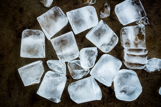 Frozen ice cubes on rustic