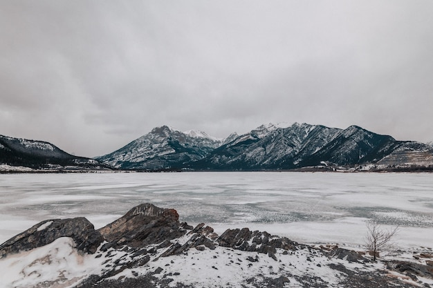 The frozen lake minnewanka at alberta, canada