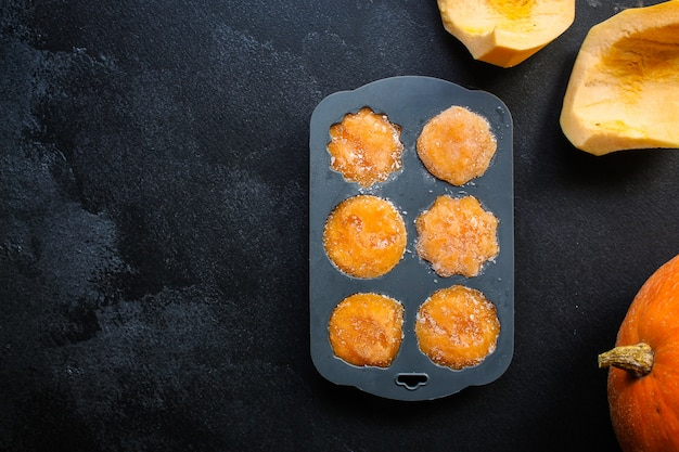 Frozen puree orange pumpkin or carrot preparation, silicone mold, vegetable puree mashed, convenience food