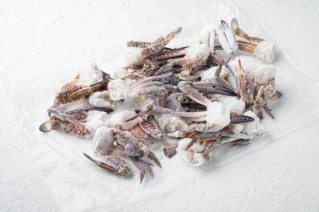 Frozen raw blue swimming crab claws set, on white