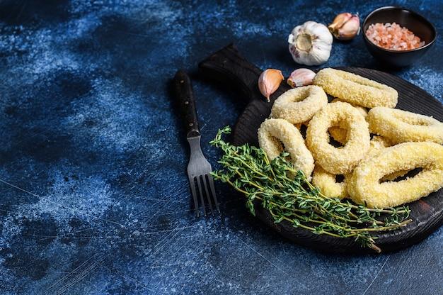 まな板のパン粉で冷凍生オニオンリング