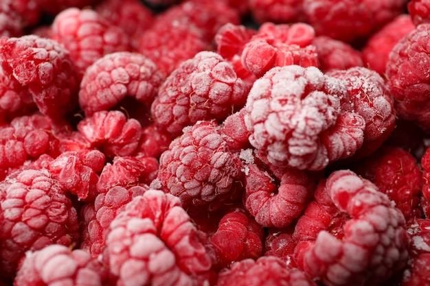 Frozen red raspberry all over background,close up