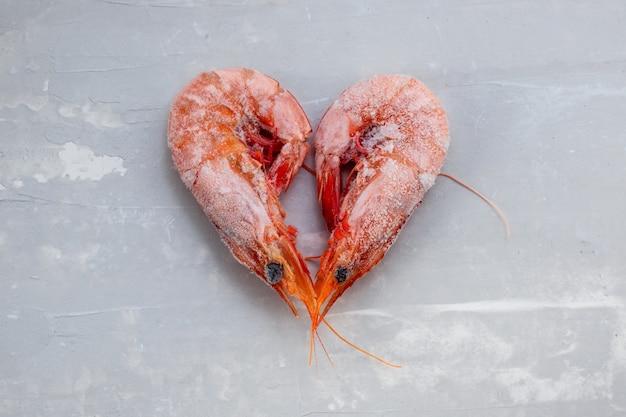 Frozen shrimps on ceramic background