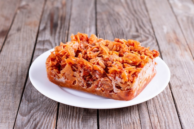Frozen stewed cabbage on a plate. frozen food, healthy food