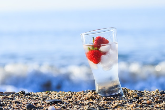 Frozen strawberry and pure water at the edge of the sea