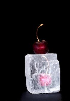 Frozen sweet cherry on black