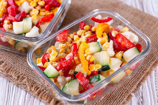 Frozen vegetable mix in a glass container
