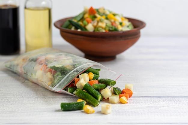 Frozen vegetables. frozen vegetable mixture of carrots, corn and peas, celery and corn.