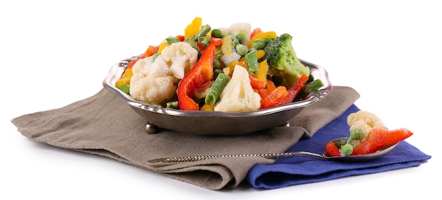 화이트 냅킨에 그릇에 냉동 된 야채